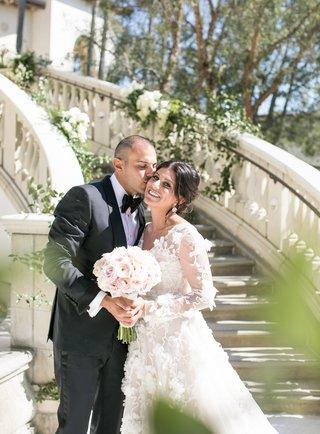 bride-in-long-sleeve-floral-applique-wedding-dress-mark-ingram-atelier-groom-in-tom-ford-tuxedo