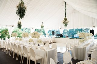 tented-wedding-reception-white-drapery-white-linens-and-chairs-ivory-florals-greenery-accents