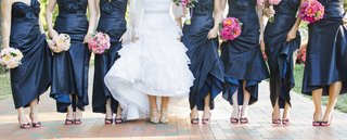 bride-and-bridesmaids-pulling-up-dresses