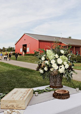 farm-wedding-in-a-red-barn-appetizer-table-with-green-hydrangeas-white-roses-foliage