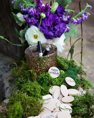 wishing-well-with-wood-coins-at-an-outdoor-wedding-at-oak-canyon-ranch-agoura-ca