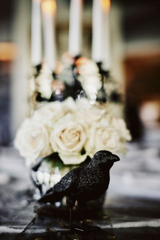 wedding-reception-halloween-theme-black-crow-black-raven-bird-decor-white-rose-flowers