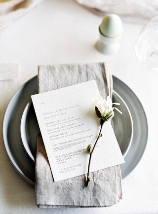 grey-charger-plate-grey-napkin-dinner-menu-with-sprig-of-magnolia-bridal-shower