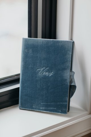 suzanna-villarreal-and-alex-wood-la-dodgers-wedding-something-blue-velvet-vows-book-with-ribbon
