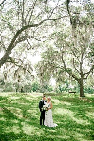 wedding-portrait-in-wedding-location-grass-lawn-tall-trees-lowcountry-south-carolina-destination