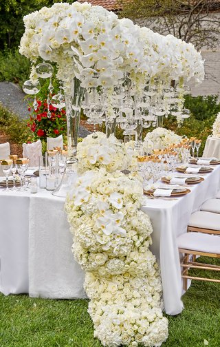 towering-centerpieces-with-orchids-and-glass-orbs-floral-table-runner
