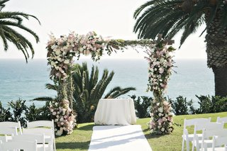 chuppah-blush-ivory-flowers-oceanside-wedding-ceremony-rustic-pastels-jewish-interfaith-wedding