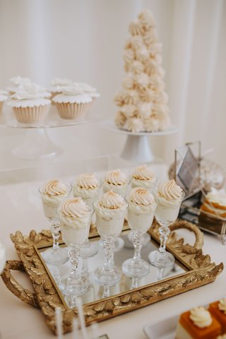 fall-wedding-ideas-dessert-table-glasses-filled-with-custard-and-meringue-mirror-gold-ornate-tray