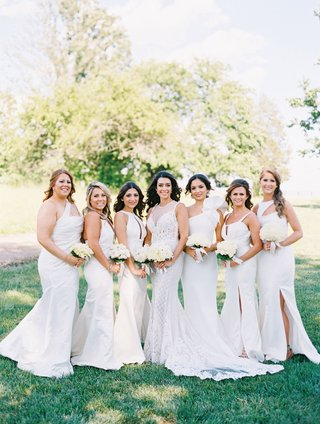bride-in-illusion-beaded-lace-wedding-dress-with-six-bridesmaids-in-mismatched-white-dresses
