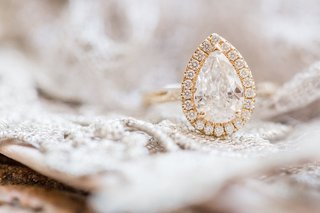 yellow-gold-engagement-ring-with-pave-halo-setting-teardrop-diamond-pear-shape-wedding-ring