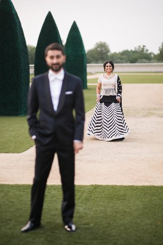 south-asian-couple-in-black-and-white-outfit-first-look-before-reception