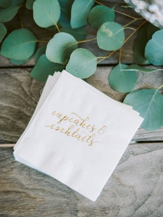 engagement-party-inspiration-white-cocktail-napkins-with-gold-emboss-cupcakes-cocktails
