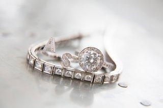 diamond-bracelet-with-initial-ring-and-round-halo-engagement-ring