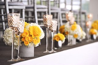 wedding-reception-with-low-bouquets-of-yellow-rose-and-white-hydrangea-flowers-in-silver-containers