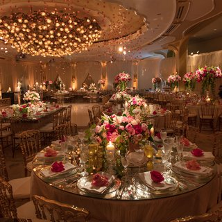 beverly-hills-hotel-ballroom-wedding-reception-pink-roses-hanging-from-chandelier-dance-floor-pink