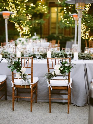 natural-chiavari-chairs-with-arrangements-of-white-flowers-and-greenery