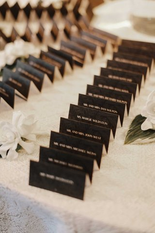 wedding-reception-white-linen-white-gardenia-flower-black-tented-escort-card-tropical-print-block