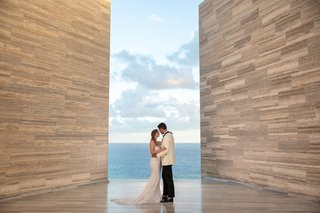 wedding-portrait-couple-in-san-jose-del-cabo-mexico-modern-hotel-solaz-berta-wedding-dress-white-tux