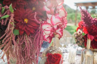 red-dark-purple-flowers-bouquets-floral-arrangements-in-gold-vases-vineyard-reception-decor