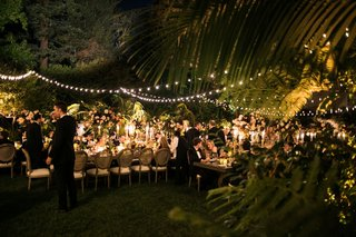 wedding-reception-hotel-bel-air-bistro-string-lights-guests-at-luxury-wedding-dinner-outside-palms