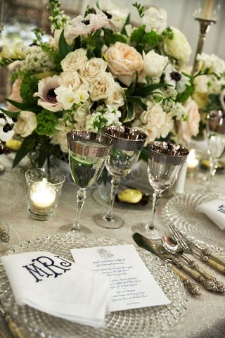 wedding-reception-place-setting-crystal-charger-monogram-napkin-menu-card-anemone-rose-centerpiece