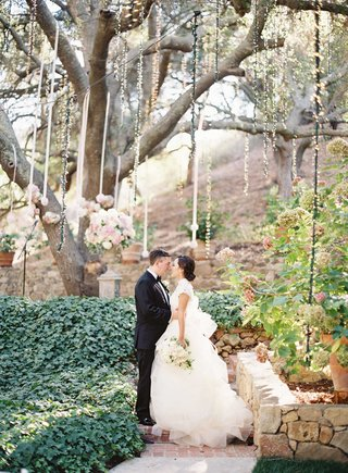 caroline-sung-and-robert-bowling-wedding-portrait-at-fairy-tale-outdoor-wedding-under-tree-in-malibu