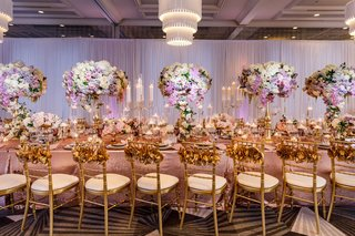 wedding-reception-long-table-decoration-ideas-candelabra-tall-centerpiece-gold-chairs-ruffle-backs