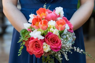 pink-rose-white-flower-orange-tulip-bridesmaid-bouquet-complementing-navy-blue-bridesmaid-dress