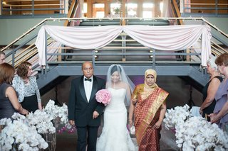 indian-bride-walking-down-ceremony-aisle