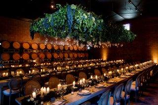 rehearsal-dinner-inside-barrel-room-with-grape-lighting-fixture