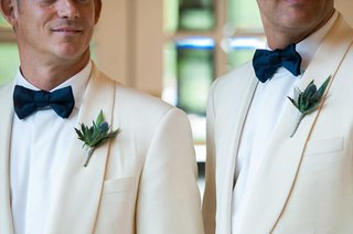 rustic-boutonnieres-made-up-of-thistles-and-frond-white-tuxedo-jacket-bow-tie