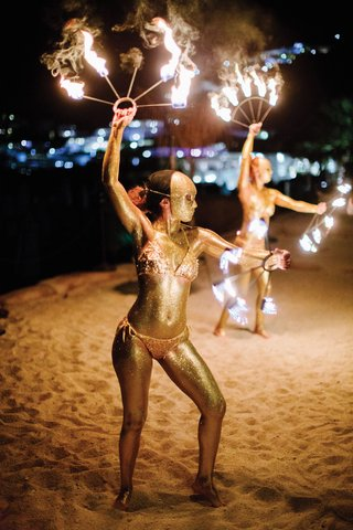 destination-wedding-in-mykonos-greece-fire-dancers-painted-gold-on-beach-entertainment-performers