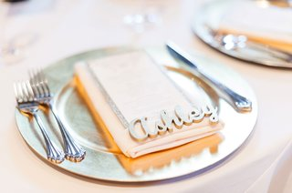 place-setting-with-charger-plate-gold-paint-wood-place-cards-laser-cut-names-on-top-of-menu-card