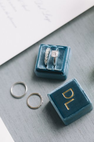 bride-engagement-ring-and-diamond-wedding-band-in-velvet-ring-box-with-last-name-initials-in-gold