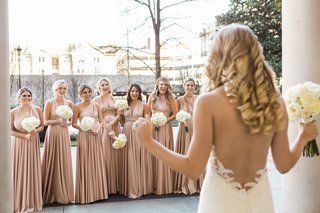 bridesmaids-face-the-beautiful-bride-as-she-presents-her-low-back-ines-di-santo-wedding-dress