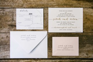 a-white-and-pink-invitation-suite-with-silver-and-gold-calligraphy