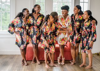 bride-getting-ready-with-bridesmaids-getting-ready-robes-black-floral-robes-warm-colors