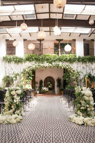 ebell-long-beach-wedding-ceremony-with-orchids-and-greenery-from-balcny
