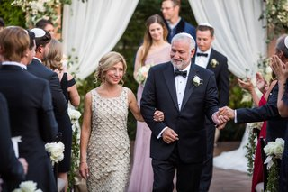 wedding-guests-and-family-parents-white-tank-dress-with-appliques-dad-in-bow-tie-suit-boutonniere