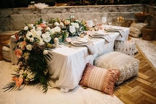 wedding-reception-or-bridal-shower-engagement-party-idea-low-table-pillow-pouf-flower-runner