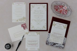 white-and-gold-zenadia-design-wedding-invites-with-vintage-stamps