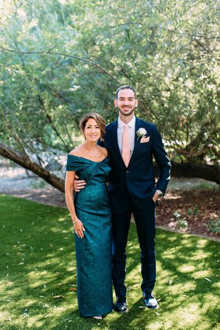 groom-in-suit-with-pink-tie-and-mother-of-groom-in-off-shoulder-teal-blue-green-gown