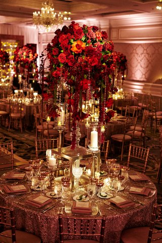 red-rose-centerpieces-with-cascading-crystals-pillar-candles-gold-linens-and-gold-chairs