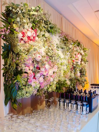 weddng-reception-bar-drink-station-decor-flower-wall-greenery-wine-glasses-and-bottles