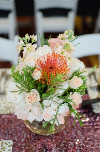 wedding-shower-centerpiece-of-pink-and-white-hydrangeas-roses-greenery-and-orange-protea-flower