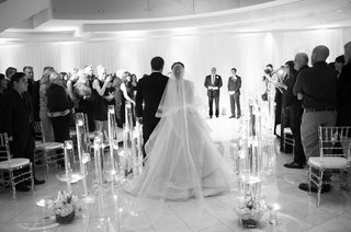 black-and-white-photo-of-indoor-ceremony-processional