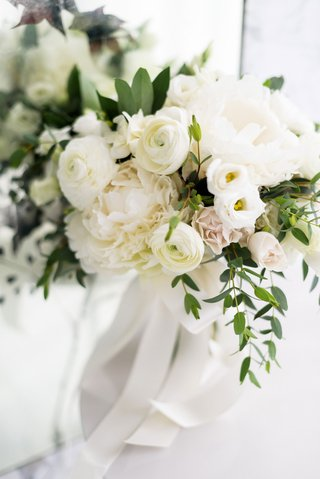 romantic-wedding-bouquet-blush-rose-white-ranunculus-and-peony-flowers-greenery-ribbon