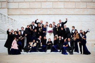 wedding-party-groomsmen-and-bridesmaids-flower-bouquet-purple-marble-stairs-venue-bride-and-groom