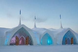 hotel-de-glace-in-quebec-city-winter-destination-wedding-ice-castle-chapel-venue-fur-wrapped-doors