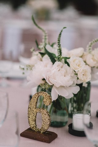 white-peony-mason-jar-centerpiece-with-diy-gold-glitter-table-number
